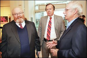 U.S. presidential historian Richard Norton Smith, left, talks with Clyde Scoles and Tom Culbertson during the Authors! Authors! event at the Main Library.