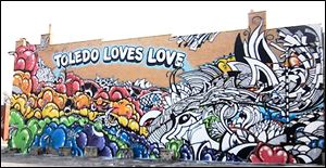The 'Toledo Loves Love' mural near downtown is just one of the artistic endeavors that call Toledo home. The city also features countless galleries and, of course, the Toledo Museum of Art.