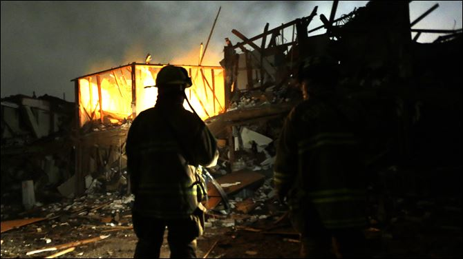 Plant Explosion Texas Firefighters use flashlights to search a destroyed apartment complex near a fertilizer plant that exploded.