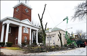 In January, crews with the Toledo Division of Parks and Forestry cut limbs from a tree along Collingwood Boulevard, north of Ban-croft Street, outside the GHDT Worship Center.