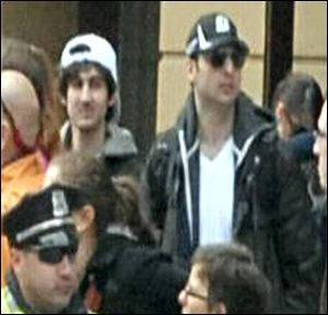 This photo released by the FBI shows what the FBI is calling the bombing suspects suspects at Boston Marathon.