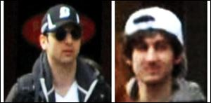 This combo of photos released by the FBI shows what the FBI is calling suspects number 1, left, and suspect number 2, right,  walking through the crowd in Boston.