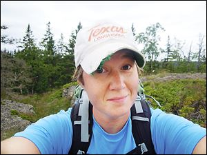 Christine O'Neil has been toting up to 45 pounds of gear on her back while using a stair-climber or hiking in Michigan's Upper Peninsula to get ready for her trek.