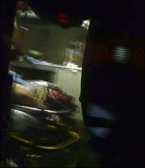 This still frame from video shows Boston Marathon bombing suspect Dzhokhar Tsarnaev visible through an ambulance after he was captured today in Watertown, Mass.