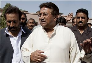 In this Monday, April 15, 2013 photo, Pakistan's former President and military ruler Pervez Musharraf arrives under tight security to address his party supporters at his house in Islamabad, Pakistan. Musharraf and his security team pushed past policemen and sped away from a court in the country's capital on Thursday after his bail was revoked in a case in which he is accus