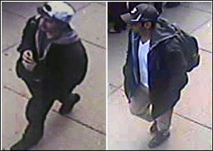 This combination of images released by the FBI on Thursday show two images taken from surveillance video of who the FBI are calling suspect number 2, left, in white cap, and suspect number 1, right, in black cap, as they walk near each other through the crowd before Monday's explosions at the Boston Marathon.