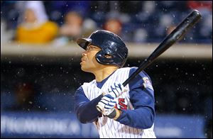 Toledo Mud Hens player John Lindsey hits an RBI triple in the fourth inning Friday against the Columbus Clippers in the second game at Fifth Third Field.