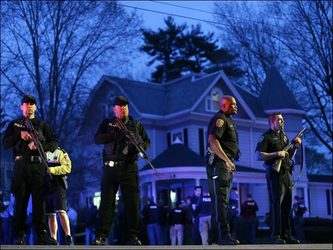 APTOPIX Police Converge Mass Tsarnaev Gunfire erupted tonight amid the manhunt for the surviving suspect in the Boston Marathon bombing, and police in armored vehicles and tactical gear rushed into the Watertown neighborhood.