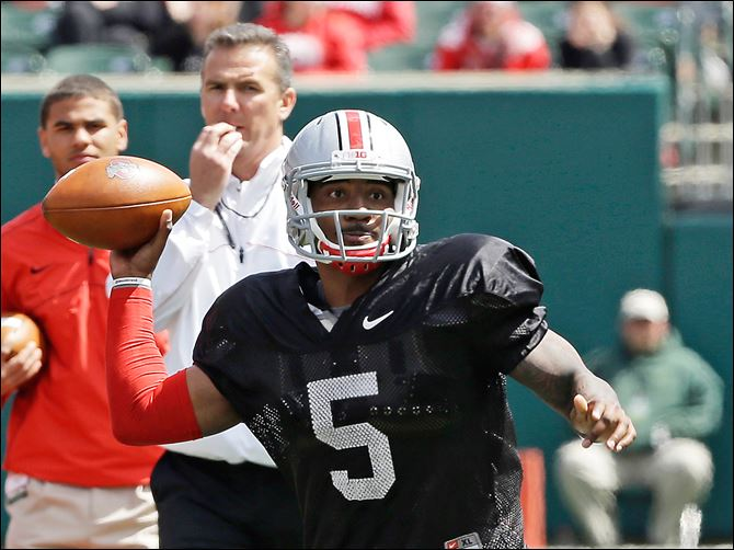 Ohio State Spring game Braxton Miller Braxton Miller passes during Ohio State's spring game under the watch of coach Urban Meyer. Miller, who will be a junior, is expected to be a Heisman Trophy favorite next season.