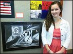 Dana Richards, a junior at Whitmer High School, shows off her first-place entry, 'Hopes and Dreams,' from the annual Congressional Art Competition.