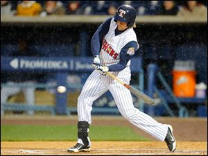 Toledo Mud Hens player Jordan Lennerton (12) hits a single in the fourth inning against the Columbus Clippers.