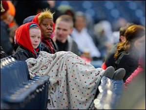 Fans try to stay warm as they watch the Toledo Mud Hens battle the Columbus Clippers.