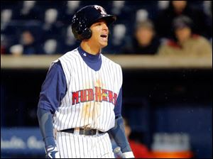Toledo Mud Hens player Quintin Berry (0) reacts to striking out against the Columbus Clippers during the 5th inning.