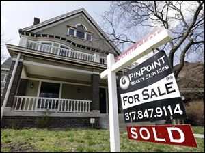 "A ""Sold"" sign is posted outside a home in Indianapolis, Tuesday, April 9, 2013. Real estate agents say pent-up demand and low interest rates are leading to a resurgence in the housing market, with home sales up 20.5 percent statewide through the first two years of the month."