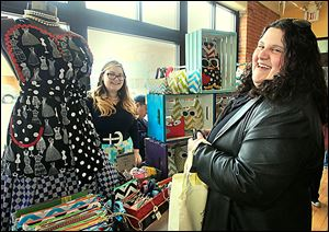 Betty Floored, left, a driving force behind the creation of Maker's Mart, chats with Joellen Cherko of Northwood. The pop-up shop featured about 50 vendors from Ohio and Michigan.