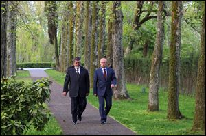 Russian President Vladimir Putin, right, and Egyptian President Mohammed Morsi walk together Friday after talks in the Black Sea resort of Sochi, Russia.