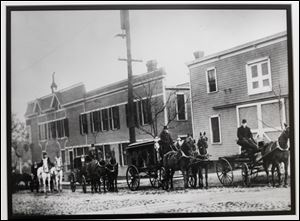 A copy of a photo of a funeral procession at the original Coyle Funeral Home on Broadway at Logan Street, taken in 1905. Copy made on April 16, 2013.