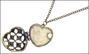 The interior of a heart locket housing processed breast milk.