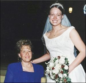 Rachel Valis, the chairman of the the Northwest Ohio American Foundation for Suicide Prevention Chapter-in-Formation, right, and her mother, Dolores Schroeder at Rachel's wedding in 2003. Mrs. Schroeder committed suicide. Family handout.