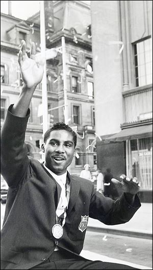 Wilbert 'Skeeter' McClure, who boxed in the Toledo PAL, waves as he rides in a parade through downtown Toledo in September, 1960, after winning a gold medal in the 1960 Rome Olympics.