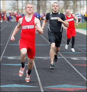 Eastwood's Isaiah Conkle wins the 100-meter dash at the Napoleon Invitational. He also won the 200.