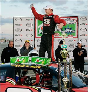 Johnny VanDoorn celebrates winning the 7Up 150 on Saturday night in the season opener at Toledo Speedway.