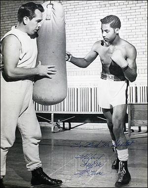 Buddy Carr, left, trains with William
