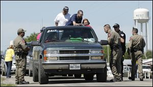 Displaced residents wait at a checkpoint for permission go back to their homes today, three days after an explosion at a fertilizer plant in West, Texas.
