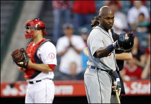 Detroit Tigers' Torii Hunter tips his helmet to the Los Angeles Angels bench prior to hitting in the first inning during. Hunter returned to Anaheim for the first time after playing five seasons for the Angels.