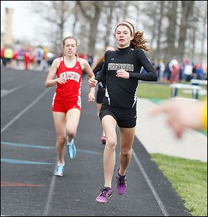 Perrysburg's Courtney Clody leads Wauseon's Taylor Vernot in the 1,600-meter run. Clody won the event.
