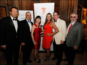 From left, Moussa Salloukh, Gus Mancy, Marla Schecht, Terri Thompson, Dean Kasperzak, and Ty Szumigala.