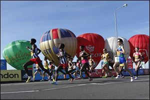 The elite women's marathon runners start their race during the London Marathon, London, today.