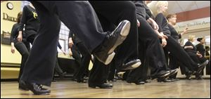 Dancers perform a scuff step during adult tap lessons at Off Broadway Dance Company at Common Space in Toledo.