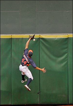 The Astros' Justin Maxwell cannot make the catch, giving the Indians' Yan Gomes a triple.