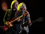 James 'JY' Young, left, and Tommy Shaw of Styx perform at the Huntington Center, playing to their faithful fan base. Styx was arguably the biggest draw to the megaconcert in Toledo.