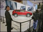 A new Jeep Cherokee is displayed at the Shanghai International Automobile Industry Exhibition (AUTO Shanghai) in Shanghai, China.