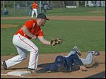 Otsego first baseman Hunter Donald tags out Lake's Jayce Vancena after a pick-off throw from Ryan Smoyer.