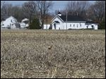 A cornfield at the southeast corner of Seaman and Coy roads is the planned location for a senior housing center backed by a Columbus developer, AlcoreSenior LLC.