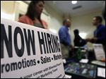 In this Thursday, Oct. 25, 2012, photo, a sign attracts job-seekers during a job fair at the Marriott Hotel in Colonie, N.Y. According to government reports released Friday, Nov. 2, 2012, the U.S. economy added 171,000 jobs in October, and the unemployment rate ticked up to 7.9 percent. (AP Photo/Mike Groll)