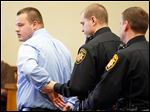 Joshua Waxler is handcuffed after being sentenced by Judge Myron Duhart in Lucas County Common Pleas Court. Waxler had entered an Alford plea to one count of endangering children.