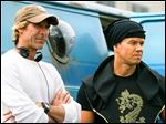 FEA Director Michael Bay, left, and Mark Wahlberg on the set of