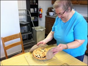 Sister Gretchen shows off the pie she baked when a Blade reporter visited.
