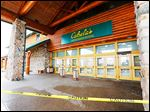 Yellow caution tape keeps customers away from the entrance to the Dundee, Mich., Cabela's store, and a notice on the firm's Web site serves notice that the retailer was closed because of fire.