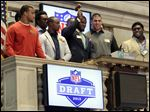 Top NFL draft prospects participated in the closing bell ceremonies Wednesday at the New York Stock Exchange. If projections hold true,  tonight could be the first time since 1953 the Big Ten didn't have a first-round selection.