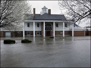 The Illinois Valley Yacht and Canoe Club is surrounded by water as the Illinois River rises out of it's banks flooding businesses and homes Tuesday, in Peoria Heights, Ill.