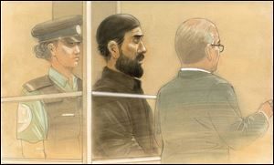 In this courtroom sketch, Raed Jaser appears in court in Toronto on Tuesday. Jaser, 35, and Chehib Esseghaier, 30, were arrested and charged Monday in what the RCMP said was the first known al-Qaeda terror plot in Canada.