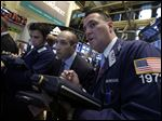Trader James Denaro, center, and Jonathan Corpina, right, work on the floor of the New York Stock Exchange Wednesday.