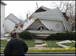 The aftermath of a possible house collapse at 1408 N. Huron St. in North Toledo.