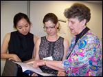 Katherine Chon, left, and Mara Vanderslice Kelly, both from the U.S. Department of Health and Human Services, talk with Sister Geraldine Nowak about a new recommendations to fight modern-day slavery.