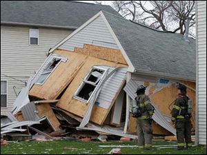 Toledo police and fire departments on the scene of a house in the 1400 block of Huron Street that collapsed.